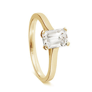 solitaire single stone ring yellow gold with baguette diamond