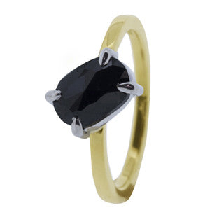 black diamond ring on yellow gold band with silver claws