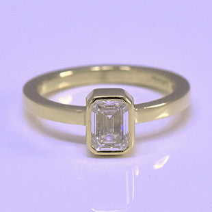 emerald cut diamond yellow gold solitaire ring