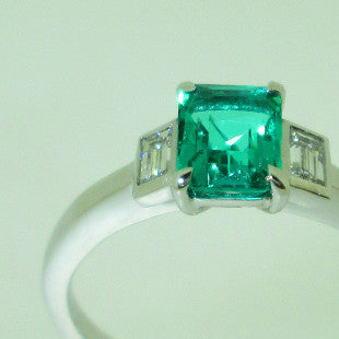 emerald engagement ring three stone bespoke