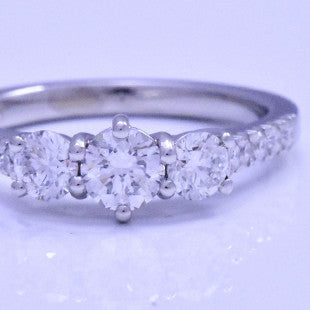 three diamond claw set engagement ring
