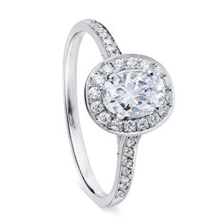 oval silver diamond ring with halo and tapered shoulders