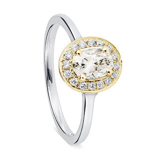 yellow gold and silver oval diamond with halo