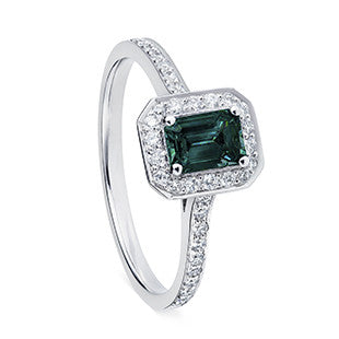 green teal tourmaline ring with diamond halo on silver band