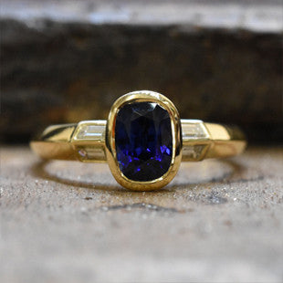 oval sapphire and yellow gold ring