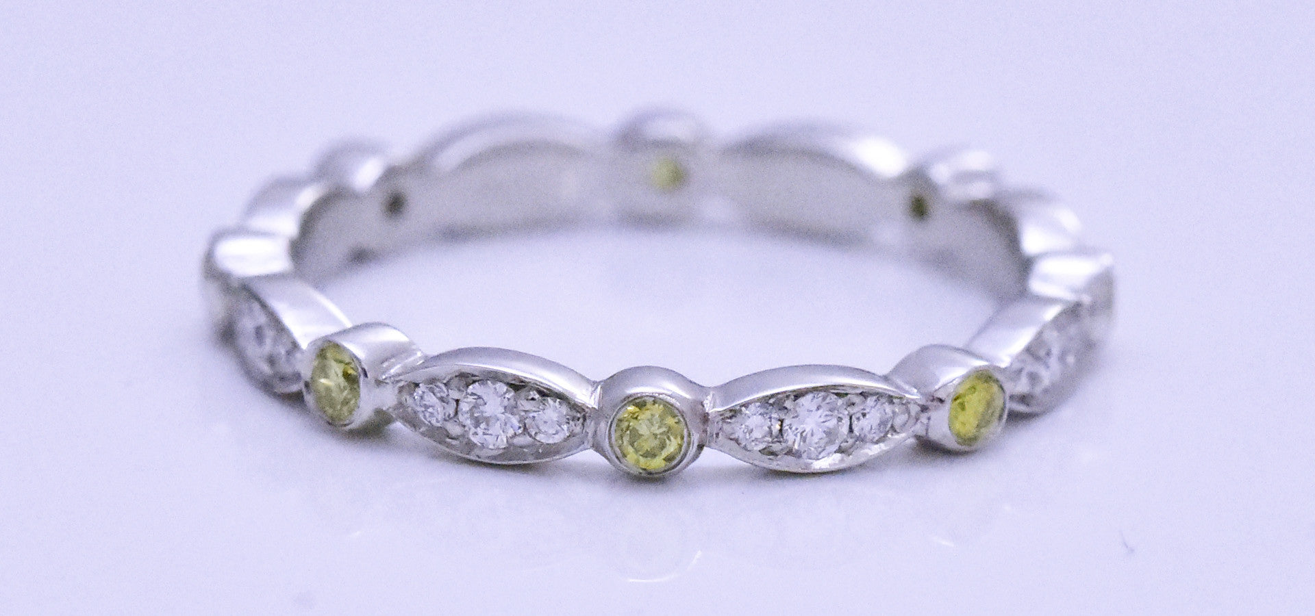 yellow and clear diamond wedding band