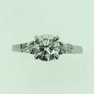 round diamond ring with pear shoulders