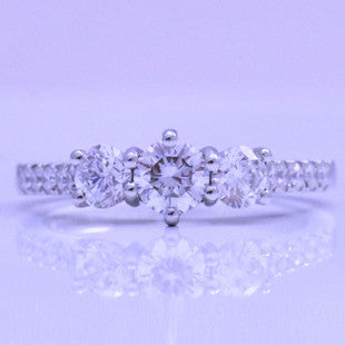 handmade platinum claw set diamond ring