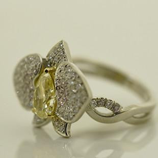 yellow diamond orchid ring with diamonds