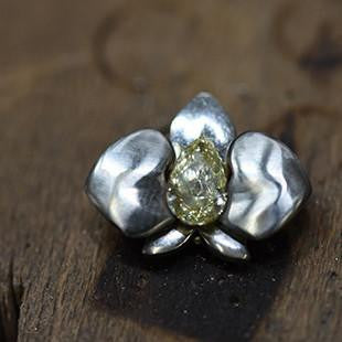 orchid ring with yellow diamond centre stone