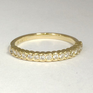 yellow gold eternity scallop band