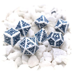 White dice with blue numbers and snowflakes