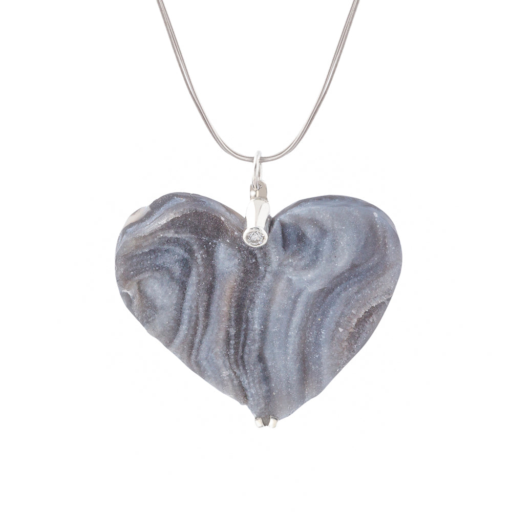 heart shaped stone pendant in grey tones set with solitaire diamond