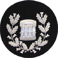 Silver bag pipe badging