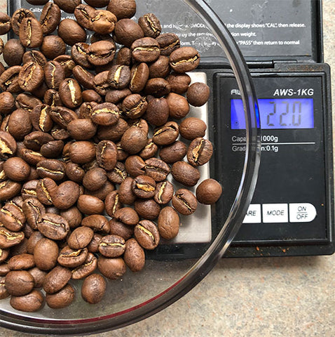 color coffee beans on a scale for pour over coffee