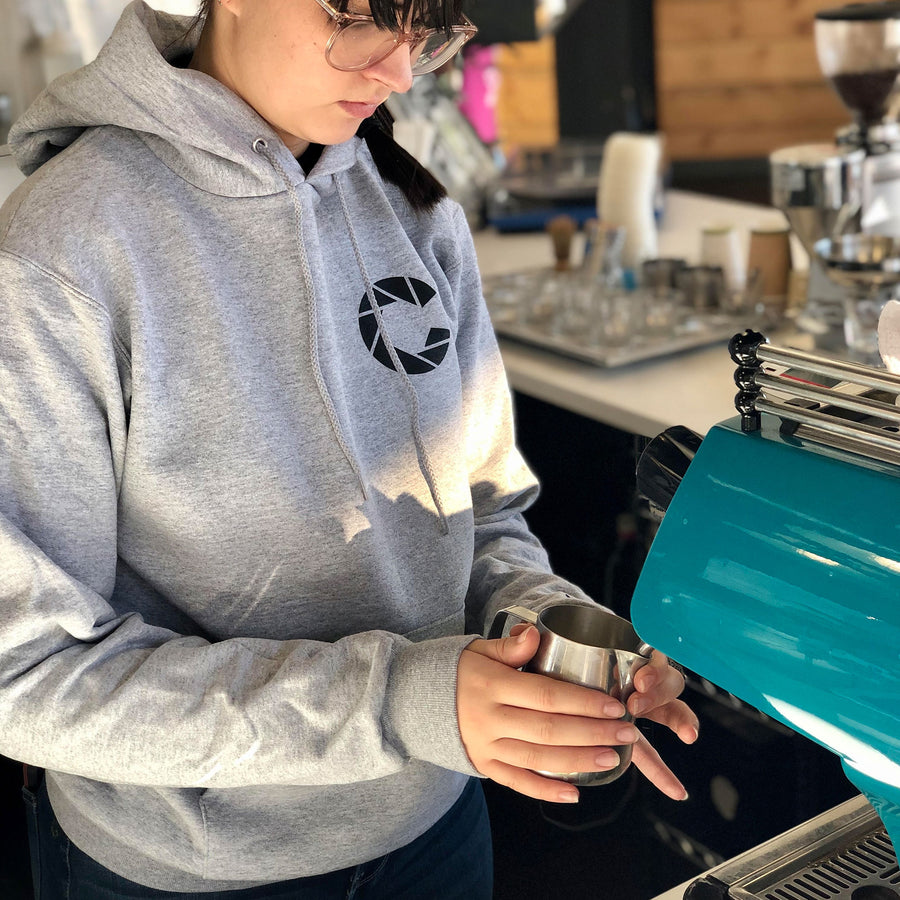 Color Coffee barista wearing silver grey champion hoodie