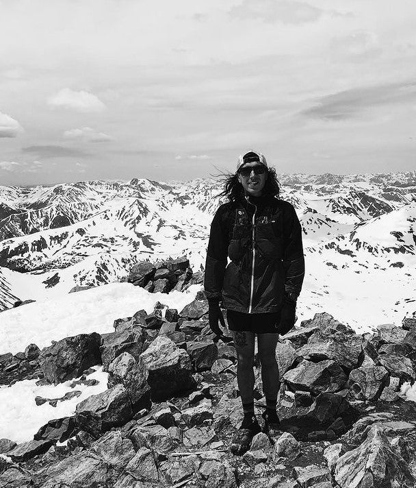 Brian Kerl at the top of the snow covered mountains