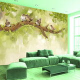 hand-painted birds tree branch mural