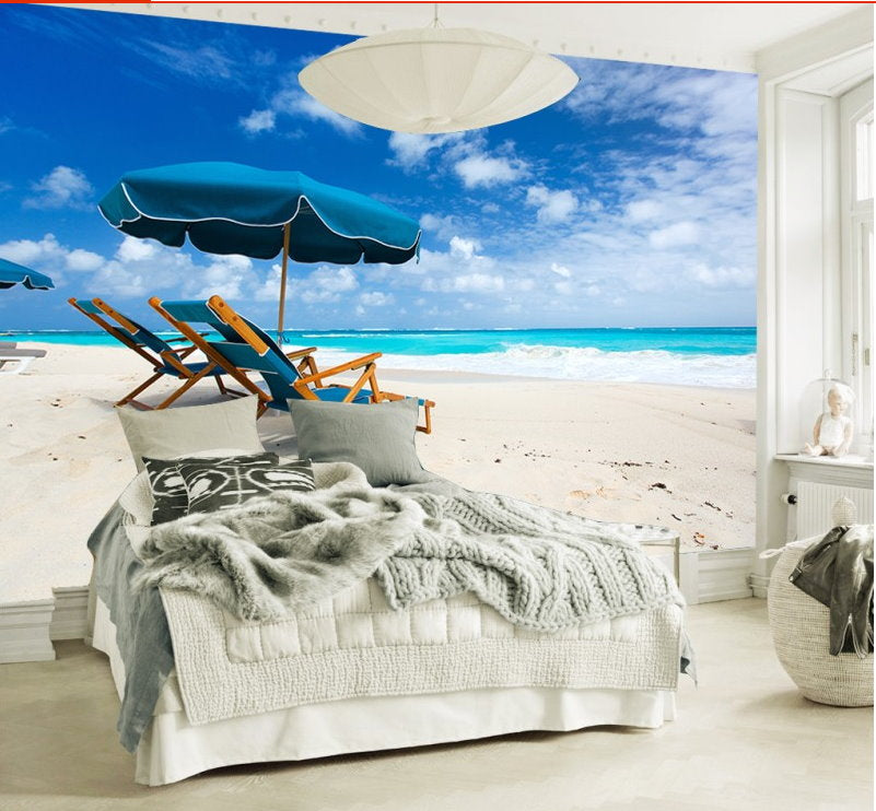 White Sand Beach With Recliner Chairs And Umbrella
