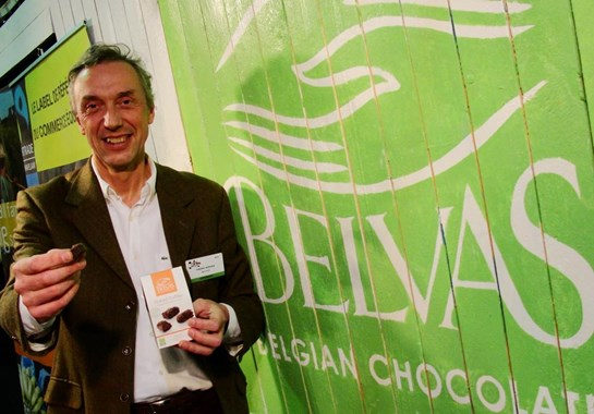 Belvas owner offering the viewer a belgian chocolate truffle