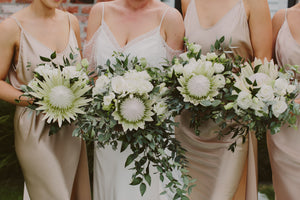 Bride and bridesmaids with bouquets. Wedding Flowers Auckland