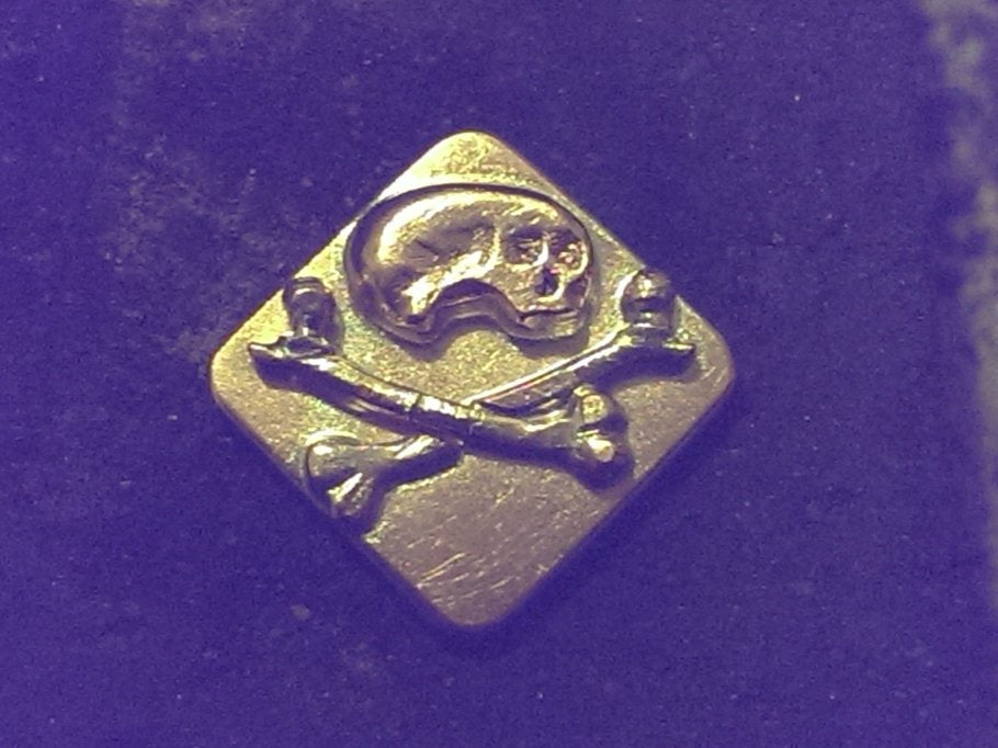 Skull & Crossbones button model - parts soldered