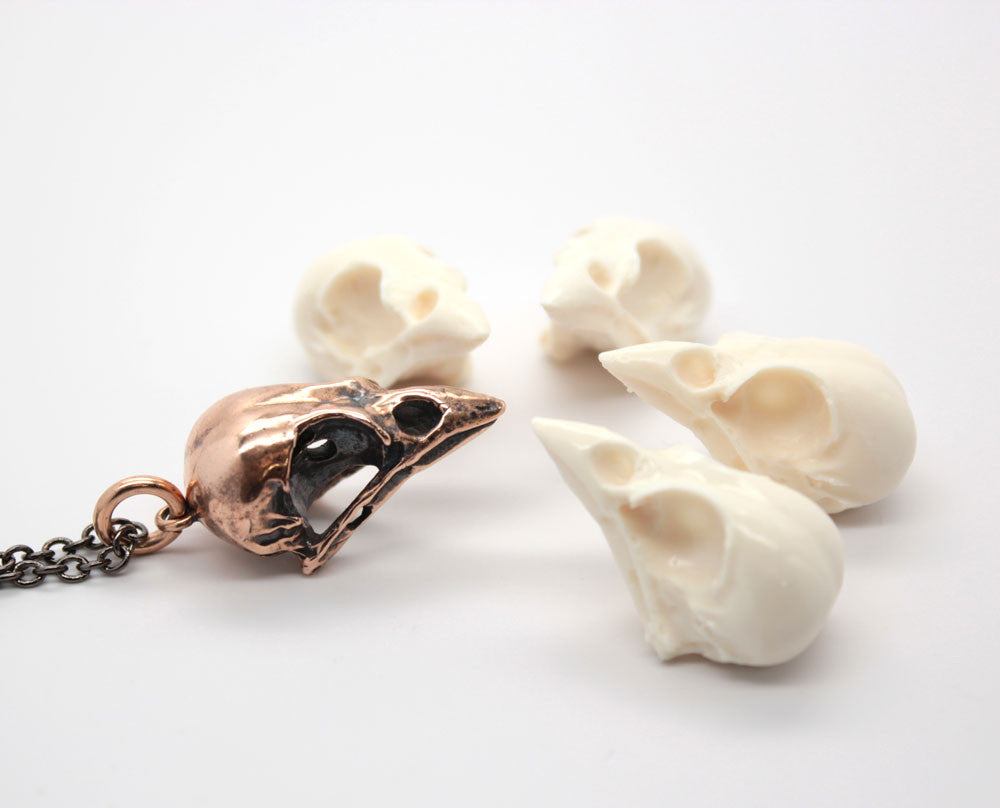 bronze sparrow skull necklace