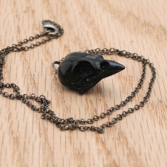 black sparrow skull necklace