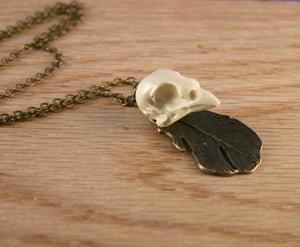 sparrow and feather necklace