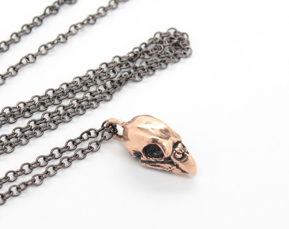 bronze mini parakeet skull necklace