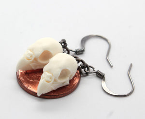 mini parakeet skull earrings