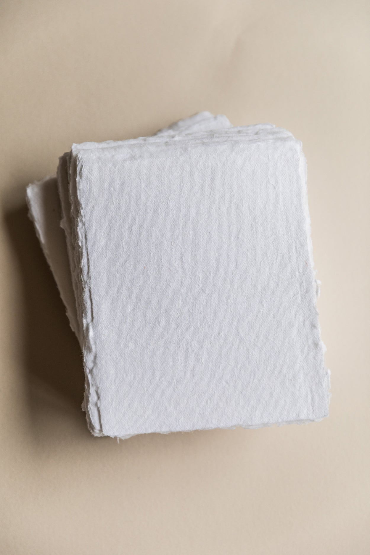 White deckle-edge cotton rag paper