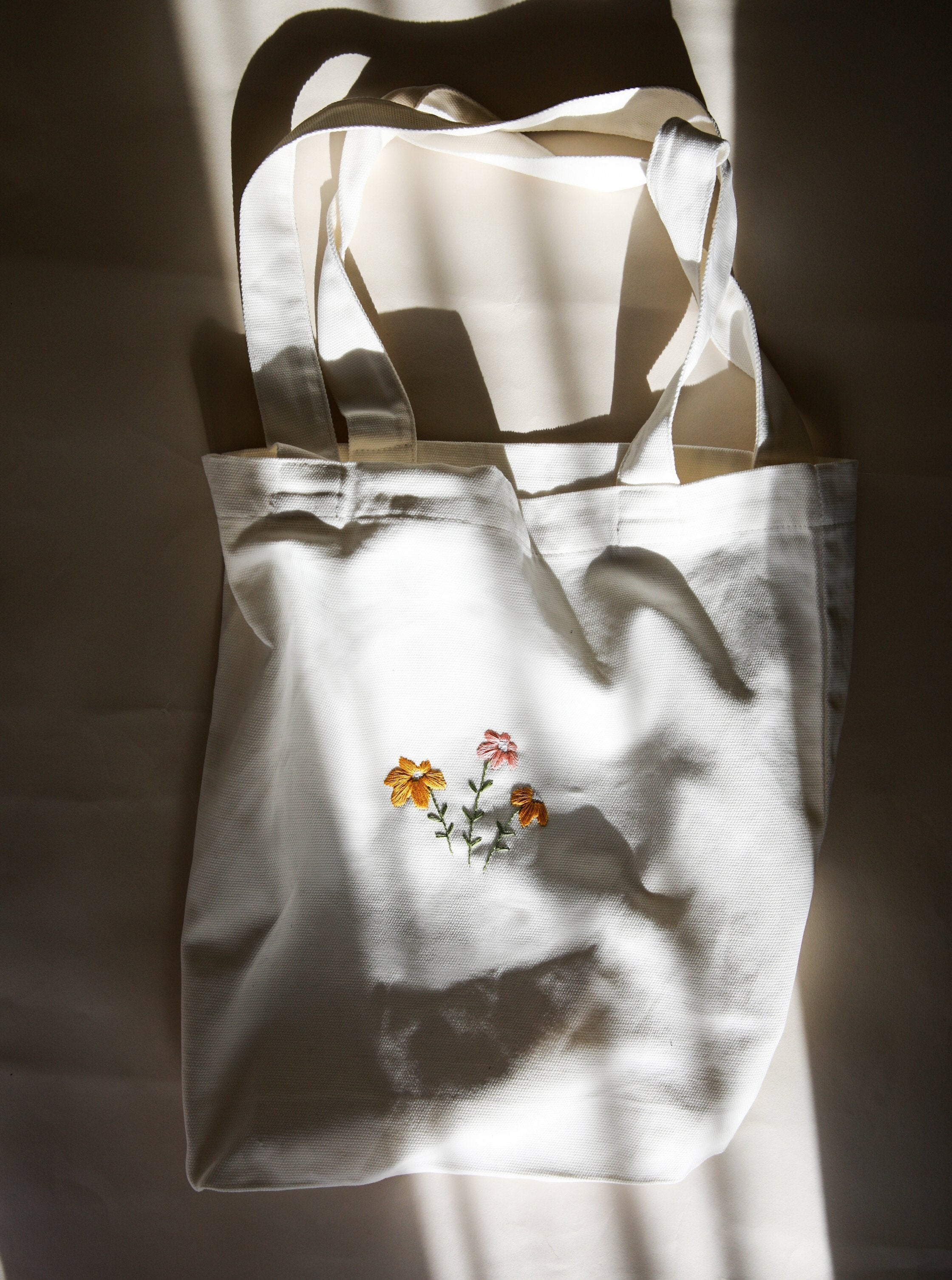 Hand embroidered daisy cotton tote bag