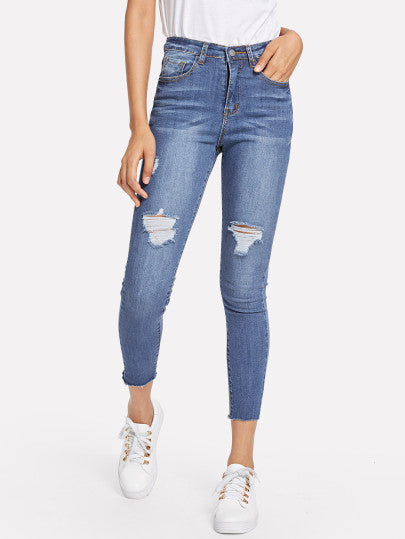 Ripped Bleach Wash Jeans