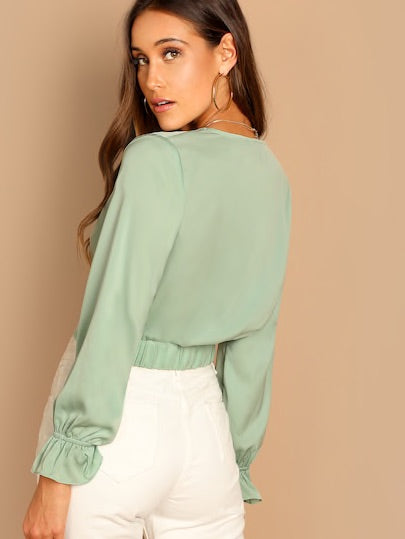 Plunging Neck Twist Blouse