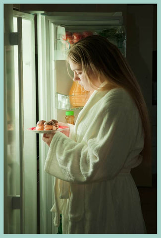 Oz-Vitamins-woman with sleep deprivation at fridge