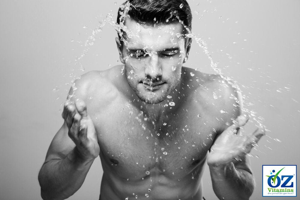Oz Vitamins Better Skin - Black and white photo portrait of man splashing water on face.