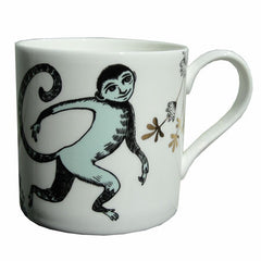 Lush designs bone china mug with light turquoise and black humanoid monkey print and gold embellishment