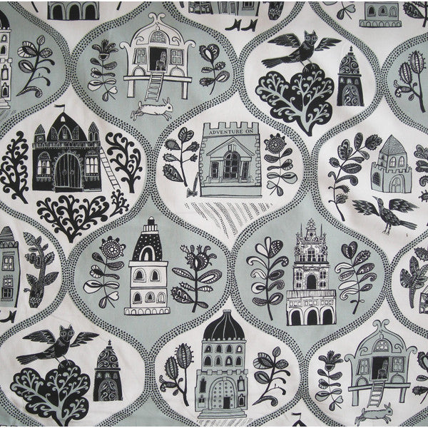 Cotton furnishing fabric in teal and black print on white featuring folksy print of buildings