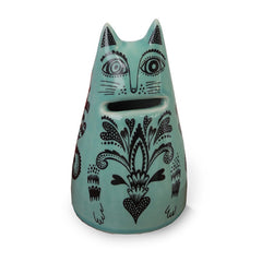 Lush Designs cat-shaped ceramic money bank with coin slot for mouth.  Turquoise with black printed pattern.