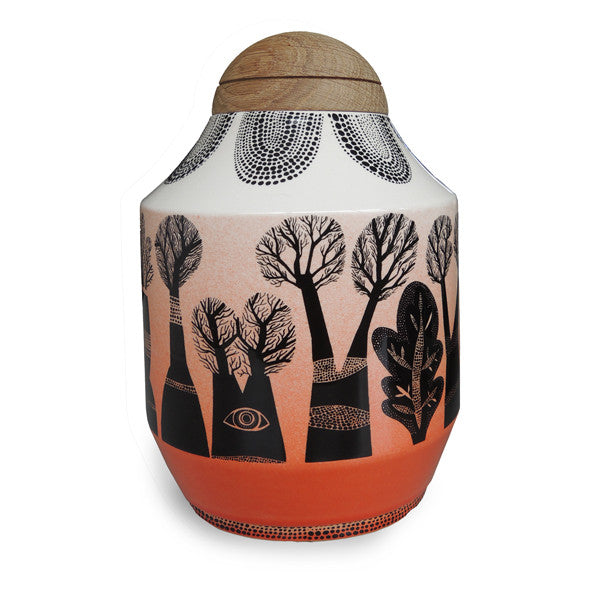 Lush Designs ceramic jar with domed oak lid, printed with trees in black and dip-dye effect orange glaze