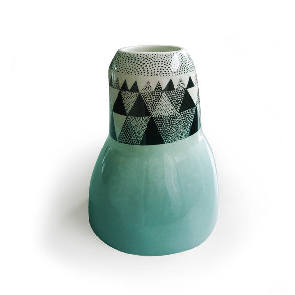 Lush designs earthenware vase in irregular shape with dipped turquoise glaze and black print of triangle pattern
