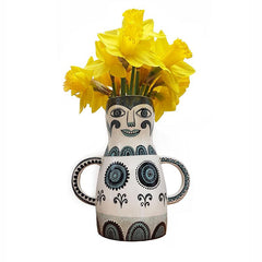 Lush Designs lady-shaped vase with daffodils