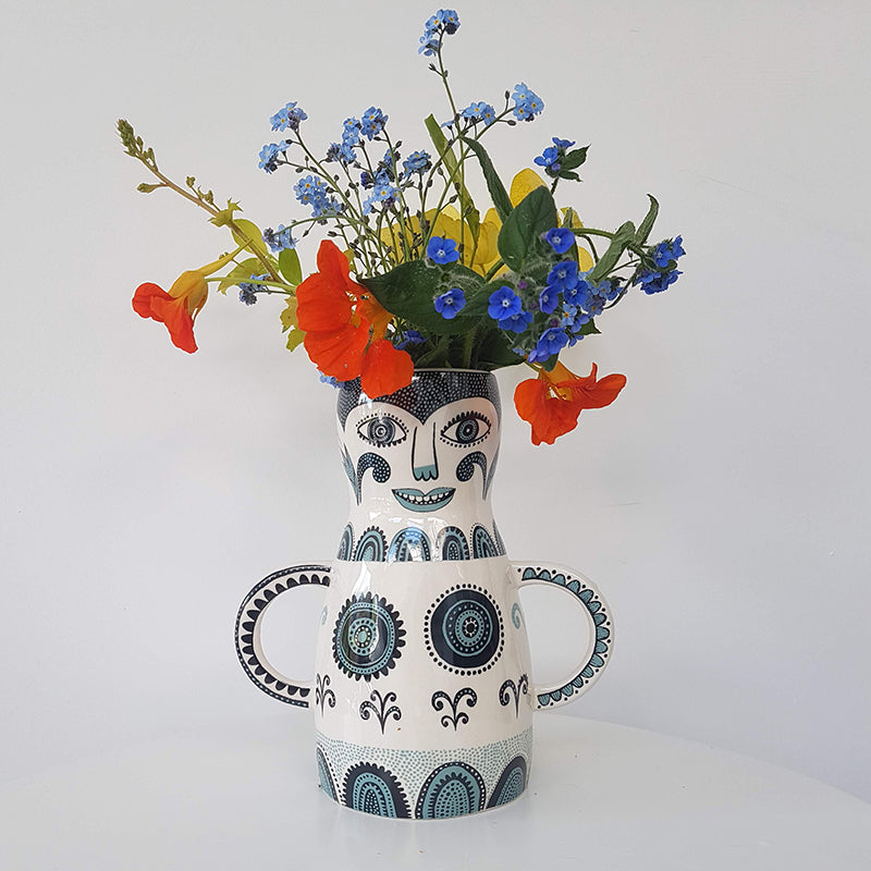 Lush designs lady-shaped vase with spring flowers in