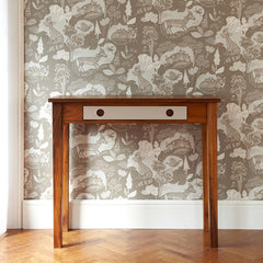 Fox and cubs wallpaper in neutral tones on a wall behind an elegant modern desk