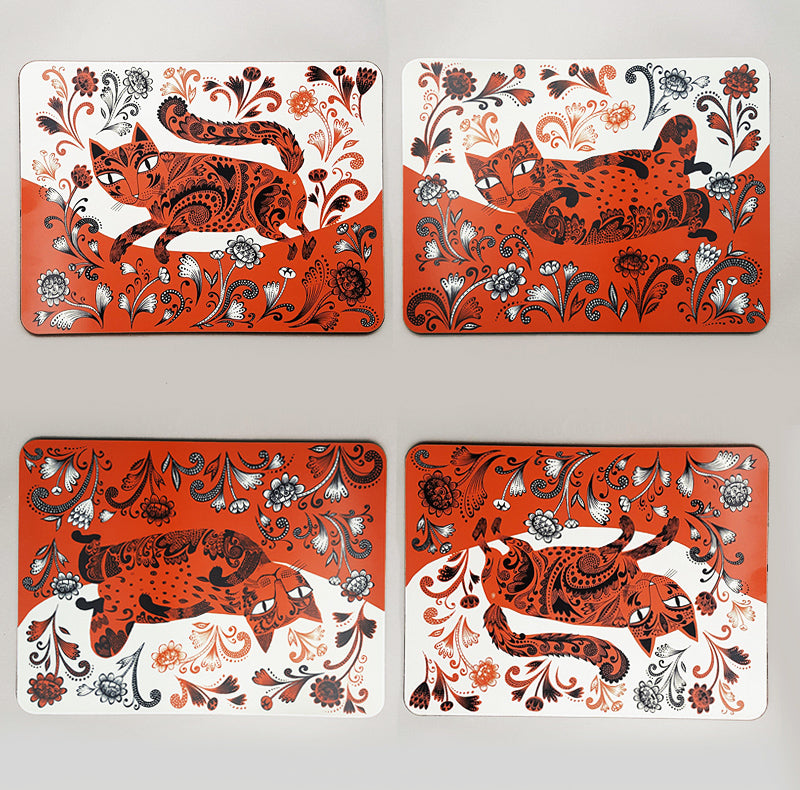 Set of 4 mats with playful tabby kitten print in orange and black