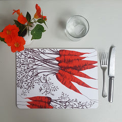 Lush Designs carrot table mat with glass of water, knife, fork and glass of water plus little jug with orange nasturtiums
