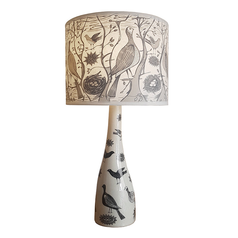 Lush Designs lamp, ceramic base with matching shade printed with partridges, trees and nests.
