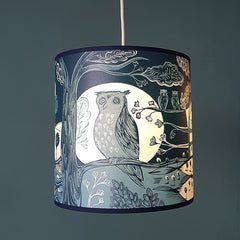 Lush designs dark blue lampshade printed with an owl in from of a rising moon