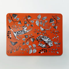 Lush Designs orange large table mat with print of cats, kitten and birds in the garden